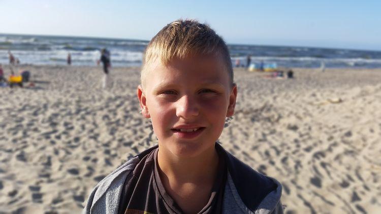 EyeEm Selects Water Portrait Child Sea Childhood Beach Sand Headshot Beach Volleyball Looking At Camera
