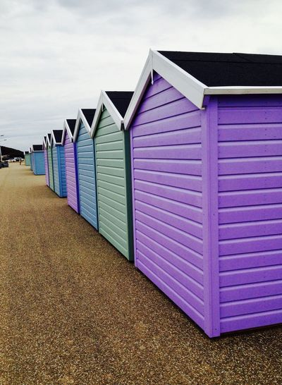 Architecture Beach Beach Hut Bright Colors Built Structure Day Gravel Path Grey Sky Holidays Multi Colored No People Outdoors Perspective Sea Sky