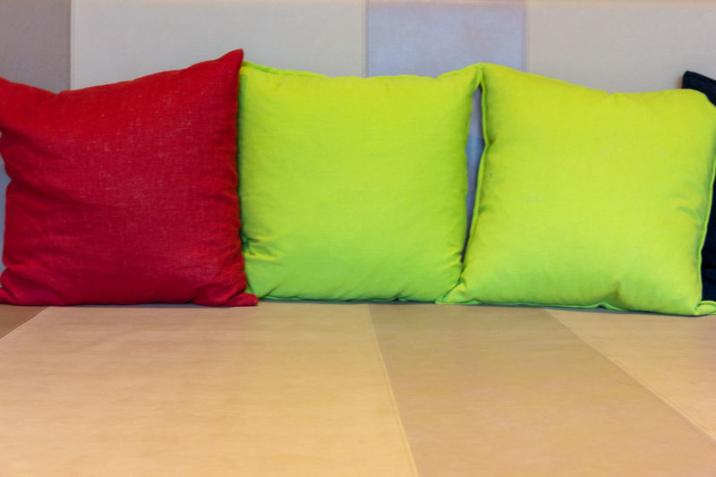 colorful pillows on sofa in living room Furniture Indoors  Pillow Red Stuffed No People Sofa Cushion Multi Colored Domestic Room Yellow Home Interior Comfortable Textile Green Color Close-up Relaxation Cozy Absence Side By Side