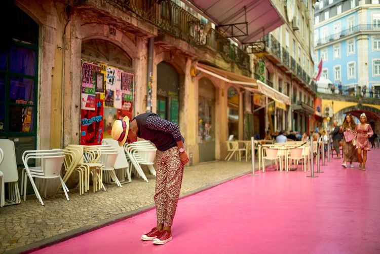Pink Panther. Style Man Lisboa Lisbon Portugal Street Pink Street LEICA M Leica Streetphotography Street Photography ELMARIT-M 28mm F2.8 Leicacamera EyeEmNewHere Dressed Up Building Exterior Architecture Built Structure Real People Adult City Day Lifestyles EyeEmNewHere