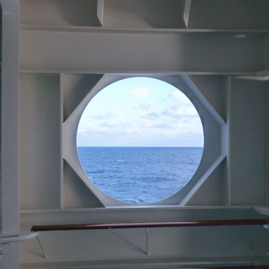 Caribbean Sea view through a ship's round window frame. Sea Horizon Over Water Water Sky Scenics Window No People Nature Arch Beauty In Nature Day Cloud - Sky Indoors  Close-up Architecture Caribbean Sea Caribbean Life Ocean View Metal Circle Squared Circle Travel