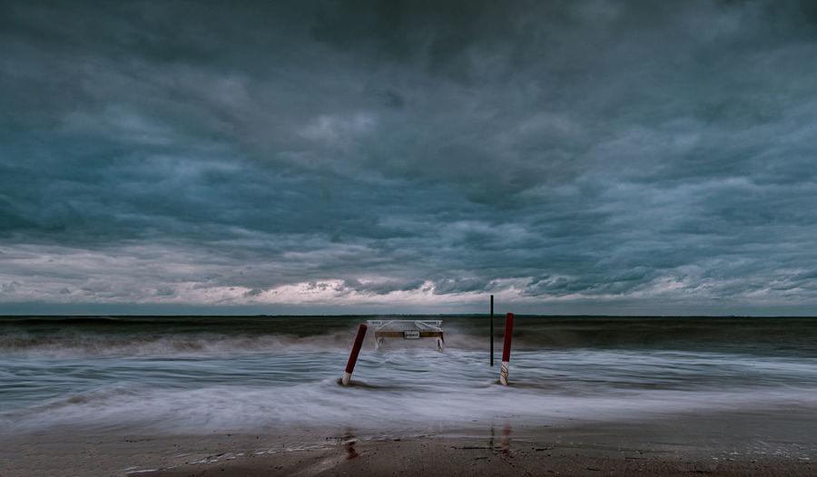 Scenic view of sea against sky ocean storm pier