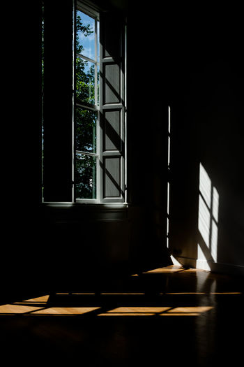 Sunlight streaming through window of house
