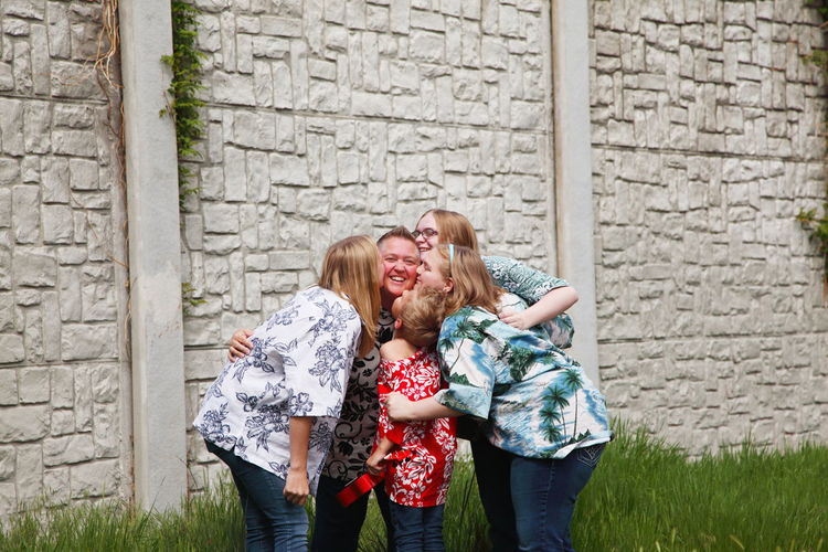Mother and Children Lgbt Architecture Bonding Boy Brick Wall Building Exterior Casual Clothing Children Front View Gay Girl Happiness Lesbian Looking At Camera Love Mother Mother's Day Outdoors Portrait Real People Smiling Standing Togetherness Woman Young Adult Young Women