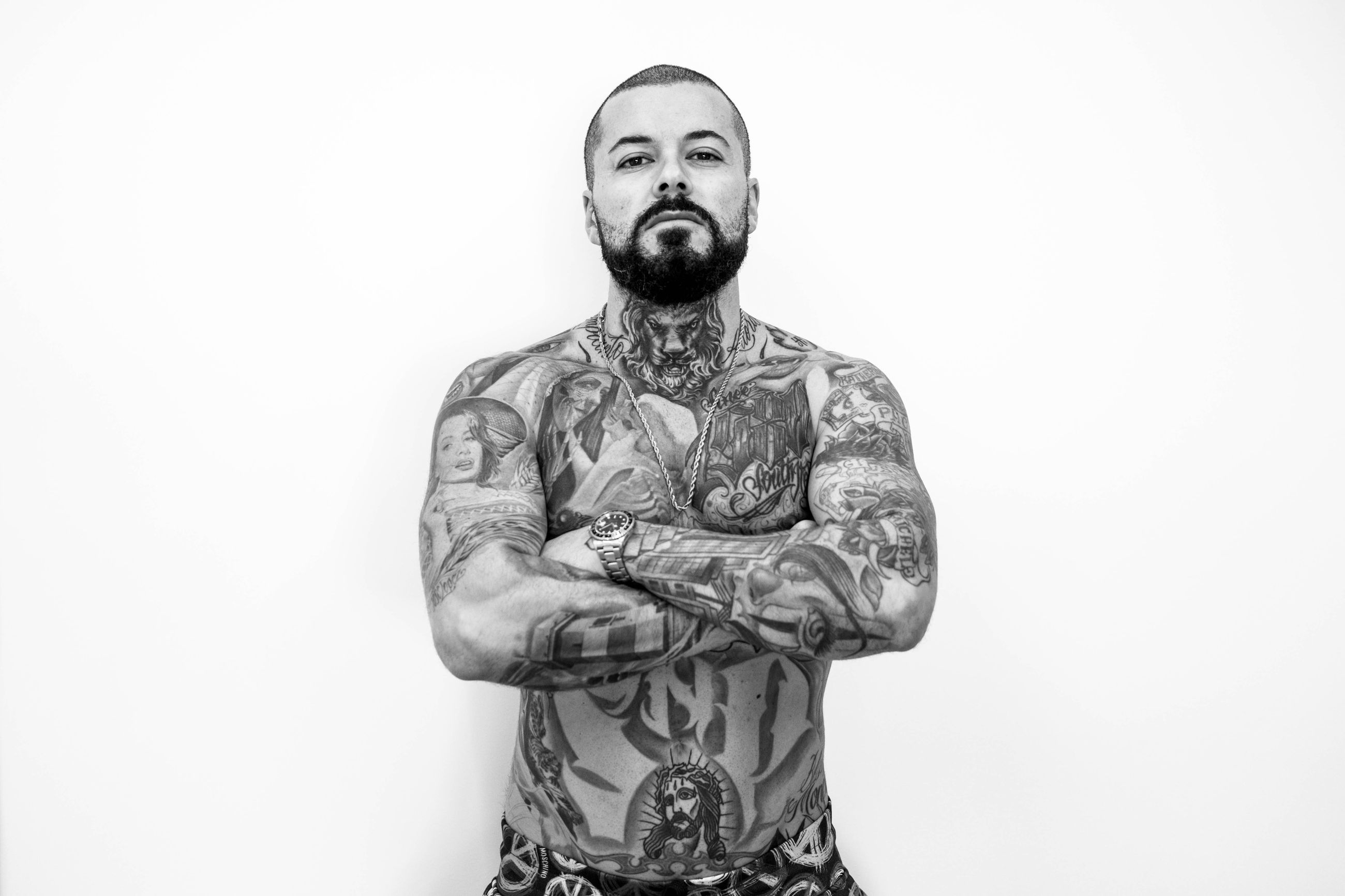 studio shot, front view, one person, white background, looking at camera, indoors, tattoo, mid adult, mid adult men, portrait, cut out, copy space, males, facial hair, adult, standing, beard, young adult, men, isolated