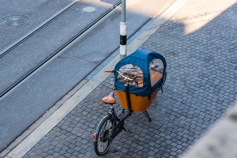 bike with cargo Adult Bicycle Bicycle Basket Bicycle Lane City City Life City Street Cycling Day High Angle View Land Vehicle Lifestyles Mode Of Transport One Person Outdoors People Real People Riding Road Sidewalk Street Transportation Wheelchair Women