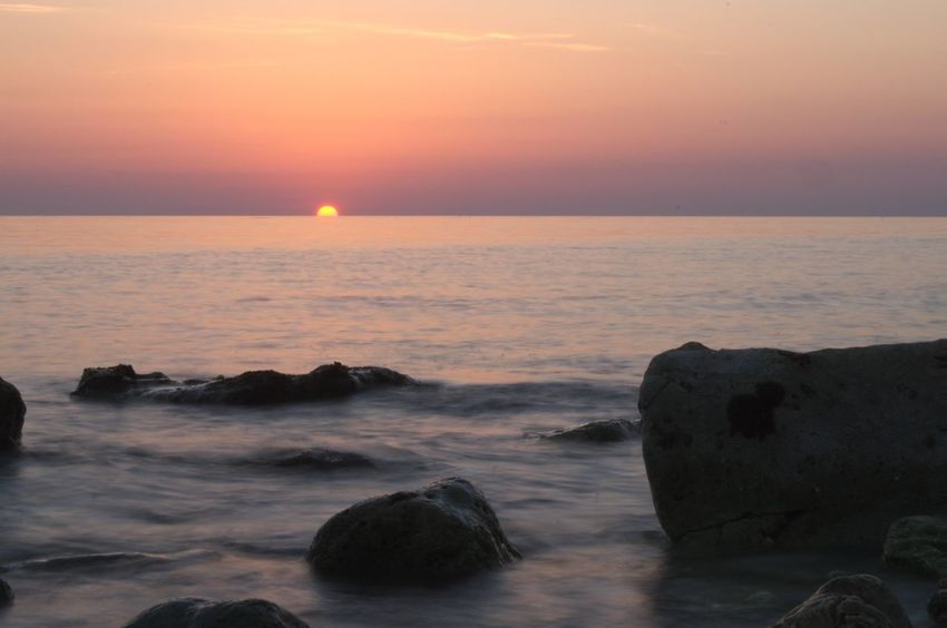 Seashore Beach Beauty In Nature Colorful Sky Day Horizon Over Water Nature No People Outdoors Rock - Object Rocks Scenics Sea Sea And Sky Seascape Seaside Sky Sun Sunset Tranquil Scene Tranquility Water Wave