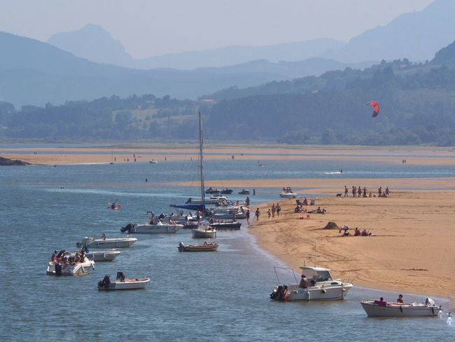 Urdaibai Water Mountain Transportation Mode Of Transportation Nautical Vessel Sea Nature Sky Mountain Range Beauty In Nature Day Scenics - Nature Land Beach Crowd Real People Incidental People Travel Outdoors