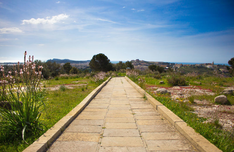Cagliari, Sardinia Castle Nature Architecture Built Structure Cloud - Sky Day Diminishing Perspective Direction Environment Footpath Grass Hill Landscape Nature No People Outdoors Plant San Michele Scenics - Nature Sky The Way Forward Tranquil Scene Tranquility Tree