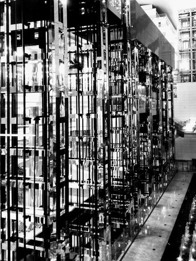 Mechanic Panoramic Dubai Blackandwhite Photography Industrial Indoors  Black & White Blackandwhite Black And White Architecture Steel Lift Mechanical Glass - Material Transparent Transportation Airport Modern Modern Architecture Interior Design Engineering Factory Industry Business Finance And Industry Airport Terminal Airport Departure Area Welding Moving Walkway  Passenger Boarding Bridge Repetition