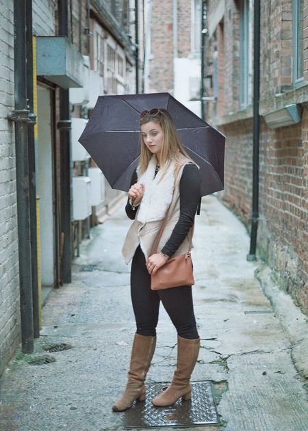 A 35 mm shot from my Generation Z series shot in York - Shot on Canon T70 #NotYourCliche A Adult Adults Only Alley Architecture Beautiful Woman Blond Hair Building Exterior Built Structure City Day Full Length Handbag  One Person One Woman Only One Young Woman Only Only Women Outdoors People Real People Standing Umbrella Young Adult Young Women