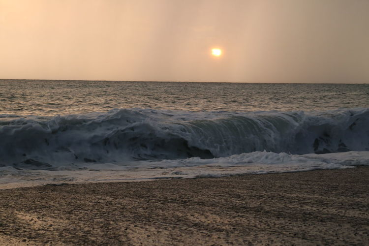 Atmosphere Beauty In Nature Horizon Over Water Moody Sky Scenics Sea Sky Sunset Sunset Againts The Storm Water Wave