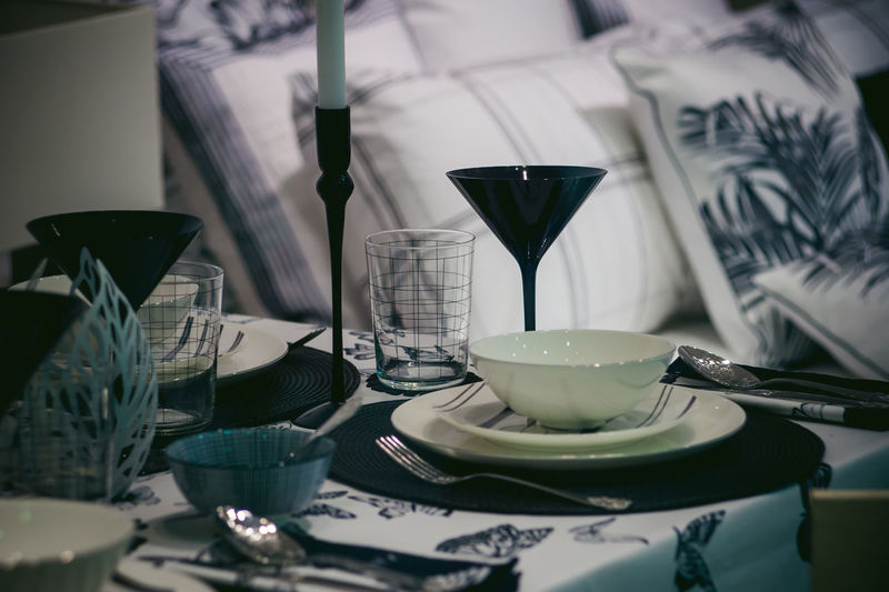 Close-up of plates and glasses on table