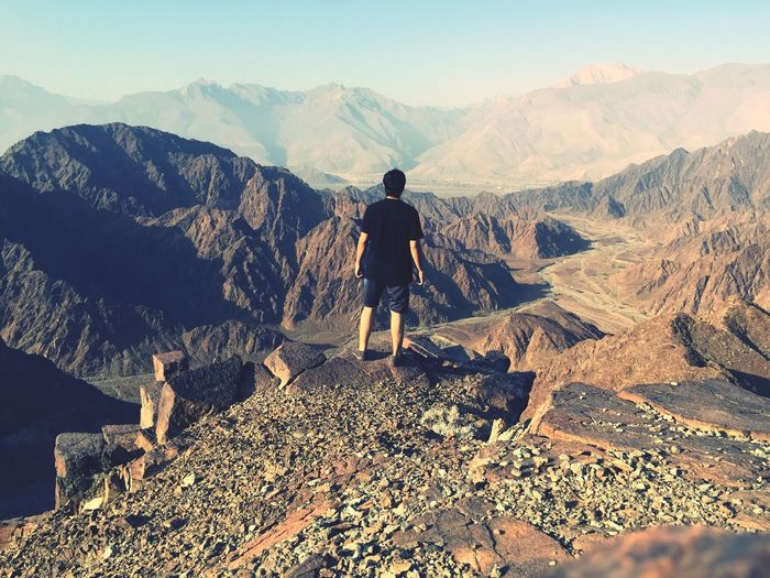 Feeling the freedom and embracing the mountains to me. Blue Black Sky Sports Embrice Oman Omani Real People Leisure Activity Scenics - Nature Adventure Nature Mountain Range Outdoors Hiking Beauty In Nature Sunlight