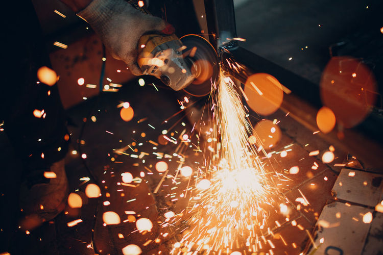 Close-up of person welding metal