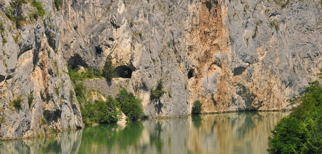 Scenic view of rock formations in water