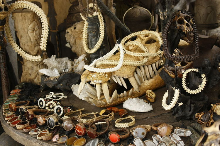 High angle view of old jewelries with animal skeletons on table