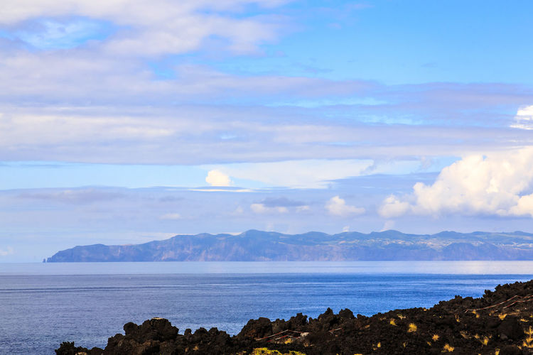 Azores Pico Island Bay Beach Beauty In Nature Cloud - Sky Day Idyllic Land Mountain Nature No People Non-urban Scene Outdoors Remote Rock Sao Jorge Island Scenics - Nature Sea Sky Tranquil Scene Tranquility Water