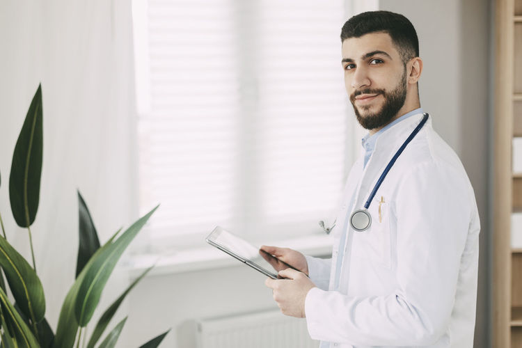 Young doctor working on digital tablet. medical concept