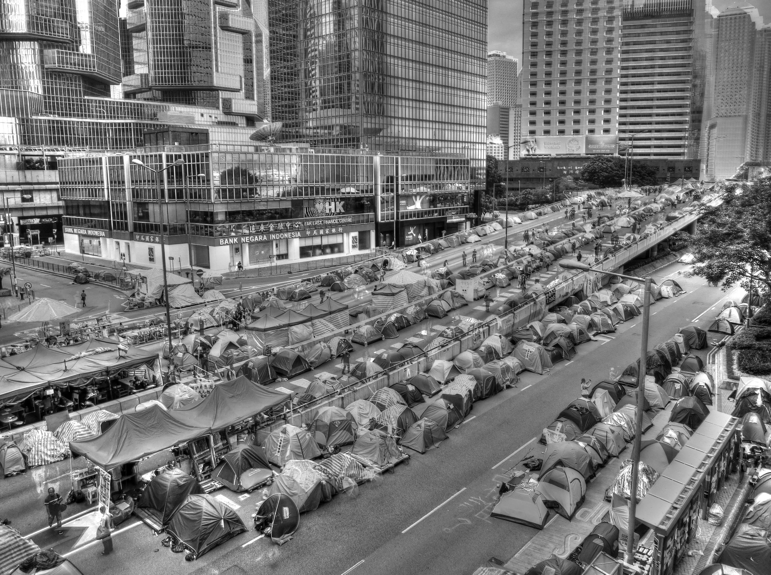 land vehicle, transportation, building exterior, city, high angle view, car, street, architecture, built structure, mode of transport, city life, road, abundance, large group of people, market, city street, outdoors, day, incidental people, crowded