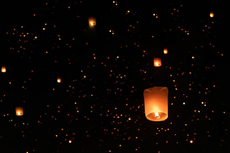 Lanterns floating in night Sky. Loi Krathong is Lantern Festival Celebrated in Thailand in November every year. Illuminated Night Lighting Equipment Glowing No People Burning Fire Fire - Natural Phenomenon Flame Nature Close-up Dark Candle Celebration Light - Natural Phenomenon Outdoors Low Angle View Luminosity Thailand Ijas Muhammed Photography Loi Krathong Festival Lantern Chiang Mai | Thailand Bangkok