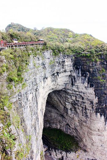 A Bird's Eye View Connection Bridge - Man Made Structure Built Structure Architecture Mountain Arch Bridge Cliff Arch Scenics Bridge Nature Tranquil Scene Tourism Water Rock Formation Beauty In Nature Stone Material Tianmen Mountain China Rocks Stones Tianmen Hole My Favorite Place People And Places