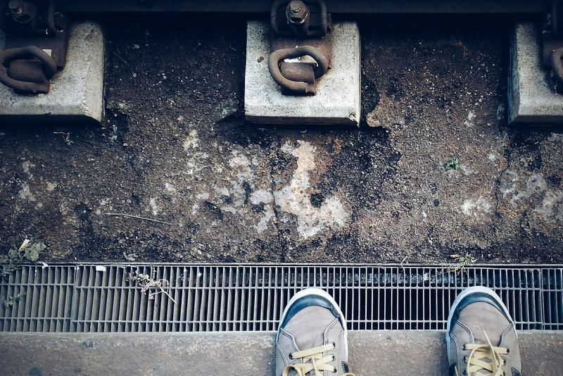Low Section Metal Outdoors Day Human Body Part Human Leg One Person EyeEmNewHere City Train Train Tracks Shoes Train Station Waiting Yellow