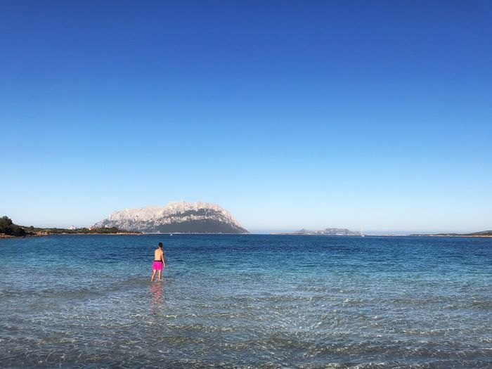 Porto Istana Beach Sardegna Sardinia Sardegna Italy  Sardinia Water Clear Sky Sea Blue One Person Real People Standing Nature Leisure Activity Full Length Outdoors Scenics Lifestyles Beauty In Nature Day Sky Horizon Over Water