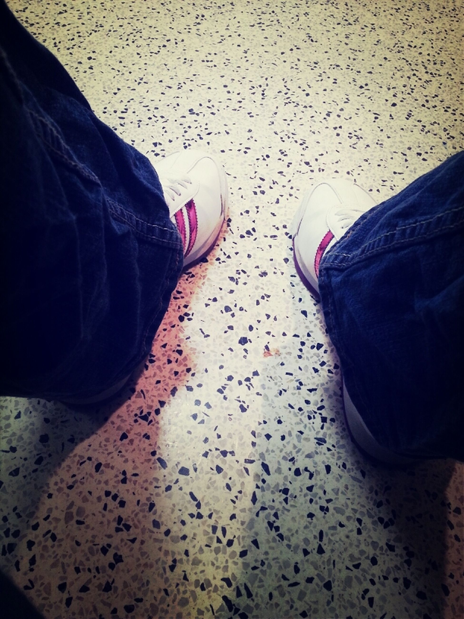 low section, person, shoe, lifestyles, jeans, standing, indoors, leisure activity, men, casual clothing, relaxation, human foot, footwear, personal perspective, high angle view, sitting