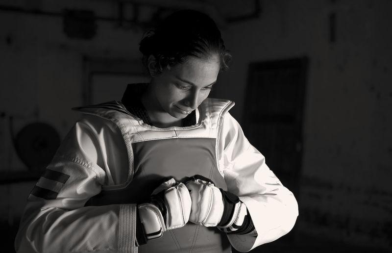 Female Taekwondo Artist Holding Helmet