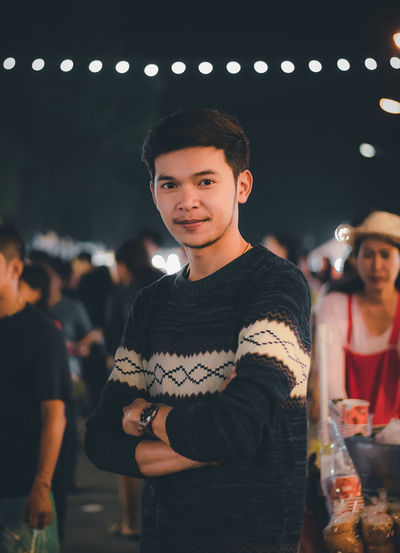 Portrait of smiling young man at night
