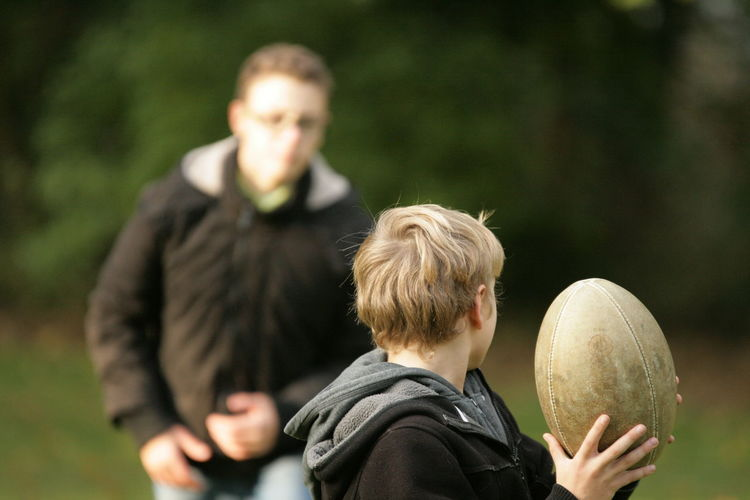 Rugby Family Rugby Ball Teenage Boys Adolescence  Lifestyles Men Males  Boys Two People Child Offspring People