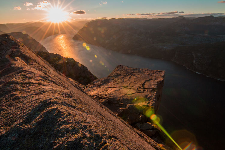 Beauty In Nature Cloud - Sky Environmental Conservation Eyesight Fjord Galaxy Gold Colored Horizon Igniting Landscape Mountain Mountain Range Nature No People Norway Outdoors Plant Preikestolen Refraction Scenics Science Sky Star - Space Sunlight Sunset EyeEmNewHere
