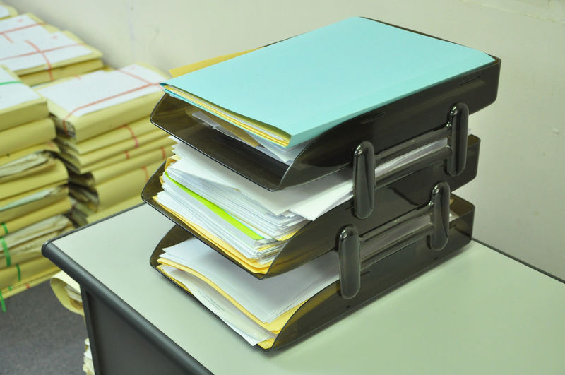 Close-up of stacked yellow papers on table