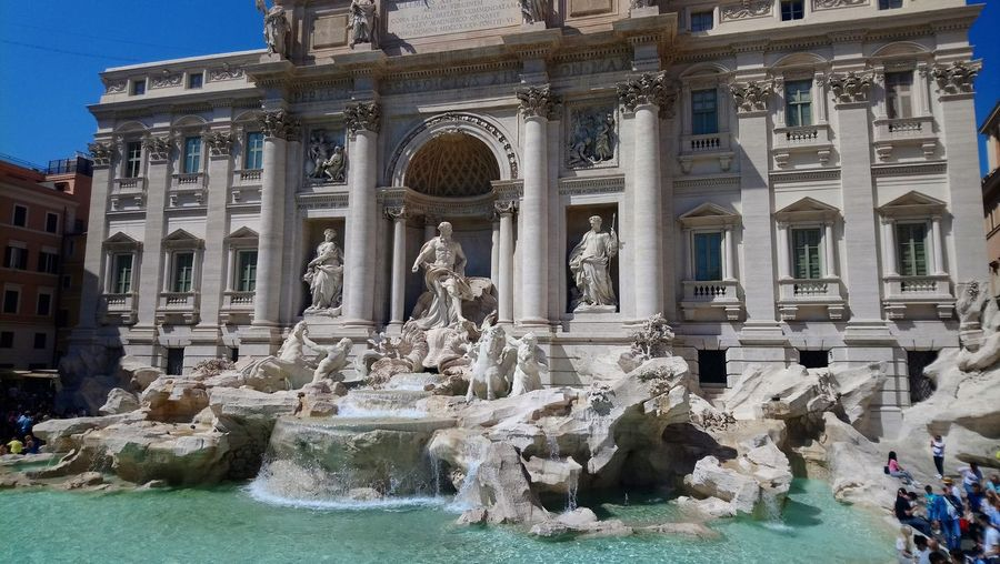 Trevi Fountain Architectural Column Architecture Art And Craft Building Building Exterior Built Structure City Flowing Flowing Water Fountain History Human Representation Incidental People Nature Representation Sculpture Spraying Statue The Past Tourism Travel Travel Destinations Water