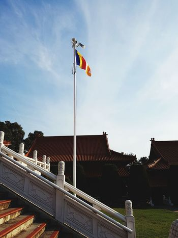 Spreading peace.. Flag Patriotism Buddhism Buddha Buddhist Temple Buddhism Culture Sky Outdoors Day No People