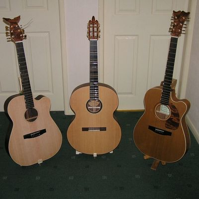 When i have the time I make acoustic guitars, I have made 5 so far and I have started on two more, I make both steel string and classical. The middle one in this image is a jumbo classical, it has a really unique sound. Luthier Guitar Acoustic Guitar Classical Guitar Wood Guitar Maker