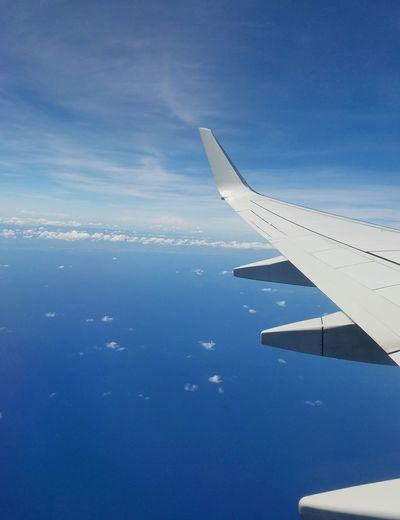 Sky And Clouds Popular Minimalism Textures and Surfaces Abstractions Freedom Blue Serenity Water Airplane Flying Aerial View Sea Blue Sky