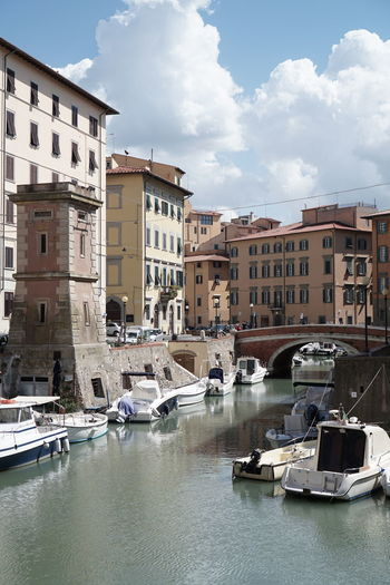 Boats moored on canal in a sunny day in livorno