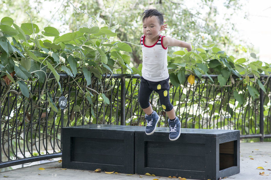 Childhood Jump Jumping Kid Play Playground Playing