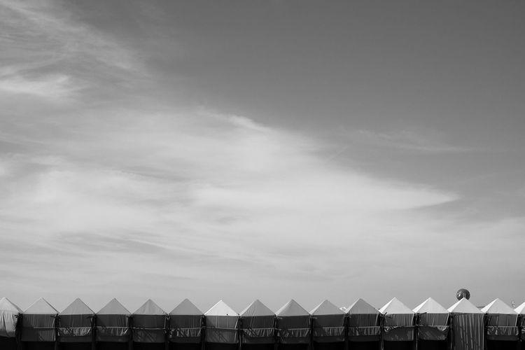 Beach Huts In Row Against Sky