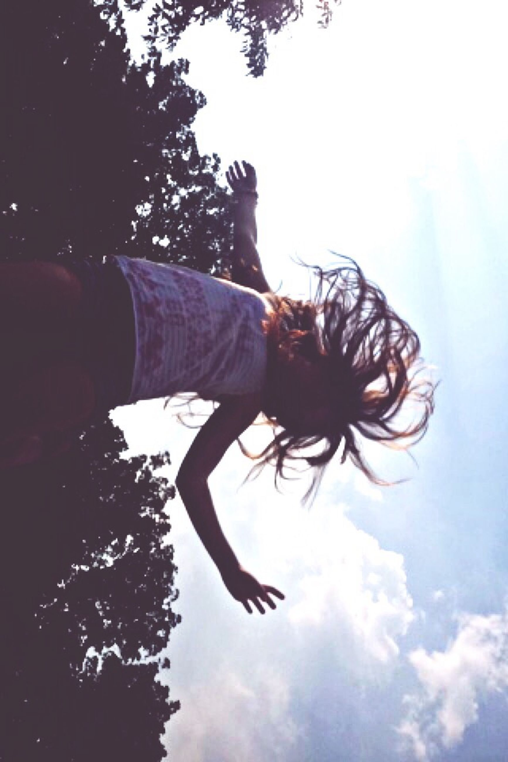 sky, silhouette, mid-air, low angle view, flying, cloud - sky, nature, outdoors, tree, full length, day, cloud, leisure activity, lifestyles, side view, beauty in nature, motion, sunlight