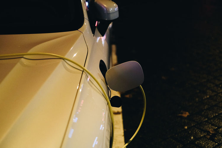 Close-up of yellow car on glass