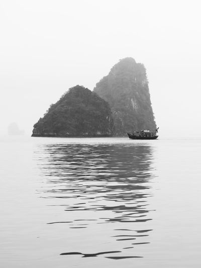 Water Sea Waterfront Beauty In Nature Sky Nautical Vessel Tranquility Nature Tranquil Scene Scenics - Nature No People Rock Day Rock Formation Clear Sky Transportation Cliff Outdoors Idyllic Stack Rock Ha Long Bay