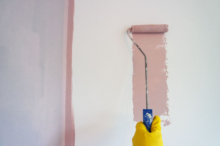 Wall - Building Feature No People Built Structure Close-up Architecture Indoors  Hanging Yellow Day White Color Copy Space Metal Home Interior Paint Paint Roller Still Life Pipe - Tube Wall Home Improvement Yellow Gloves Painting Pink Color Color Pink