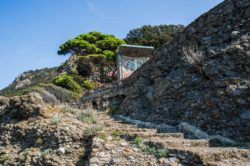 Punta Chiappa Hiking Portofino Natural Regional Park Stella Maris Travel Adeventure Architecture Battery Beauty In Nature Cliff Day Low Angle View Mountain Nature No People Outdoors Punta Chiappa Rock - Object Rock Formation Scenics Sky Tourism Tree