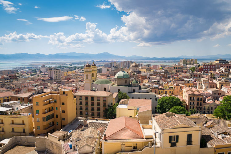 View of Cagliari, capital of the region of Sardinia, Italy. Ancient Architecture Beautiful Belfry Building Cagliari Cagliari Skyline Cagliari View Castle Cathedral Church Cityscape Colorful Dome Downtown Harbor High Historic Historical Island Italian Italy Landmark Mediterranean  Panorama Panoramic Place Roof Sardegna Sardinia Scenic Sea Skyline Tower Town Vintage