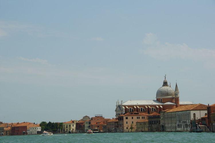 Church of san giorgio maggiore by grand canal against sky