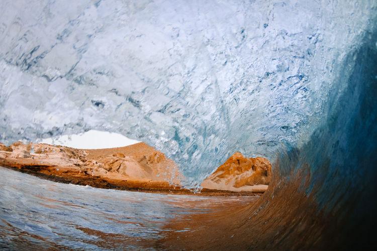 Close-up of glacier on sea shore