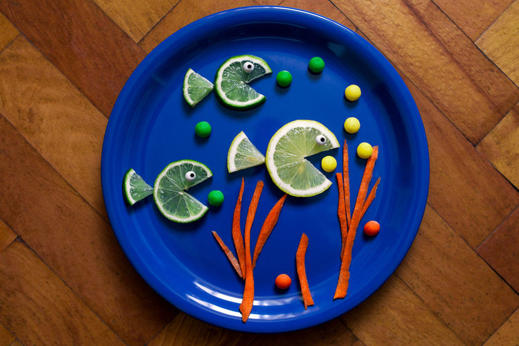 Directly Above Shot Of Lemon Slices In Plate On Table